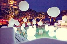 Modern Living Hawaii: Full Moon Party with balloons floating on top of swimming pool.