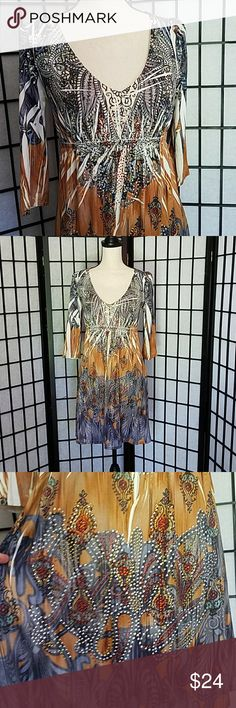 """S. Twelve Rhinestoned Boho Tie Dye Print Dress EUC Not missing a single rhinestone. The stones are red, topaz, and clear AB. Only rhinestoned on the front. I tried to capture it as best I could. Please let me know if you want more pics of the design. Elastic waist with streach. 95% polyster,  5% spandex. Does need hand washing or a lingerie bag on gentle cycle because of the rhinestones. Armpit to armpit is 16"""", Shoulder to Hem length 32"""", Waist 14"""", Sleeve Length 16 and half inches. Please…"""