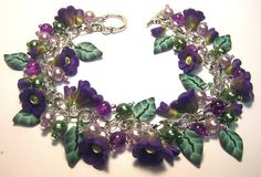 Purple Flower Charm Bracelet by ColleensCreations on Etsy, $38.00