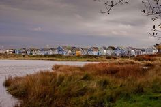 Beach huts at Hengistbury Head Dorset photograph picture print by AE Photo #beachhuts #hengistbury #pic #photographers