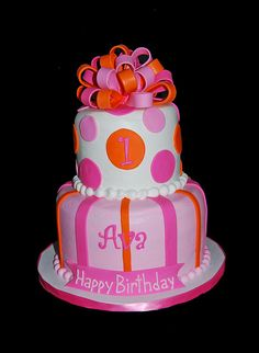 pink and orange 2 tier first birthday cake topped with a bow by Simply Sweets, via Flickr