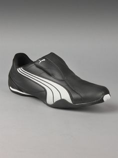 Puma® Tergament Mens Sneakers in Black.  Convenient slip on shoes from Puma are sleek and stylish. Black sneakers feature gray racing stripes, leather uppers, and a low profile. If you're a fan of Puma sneakers for men, you know this ultra-modern style would make a great addition to your collection.