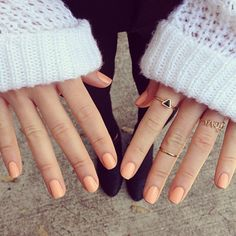 peach nail polish & delicate rings