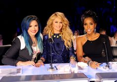 """Judges Demi Lovato, Paulina Rubio and Kelly Rowland play nice on """"The X Factor"""" on Oct. 29 in Hollywood, Calif."""