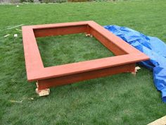 All wood sandbox plans After a year with the plastic turtle sandbox , it was time for an upgrade. Build A Sandbox, Wooden Sandbox, Kids Sandbox, Kids Water Table, Water Tables, Outdoor Play Spaces, Fish Ornaments, Tree Roots, Outdoor Tables