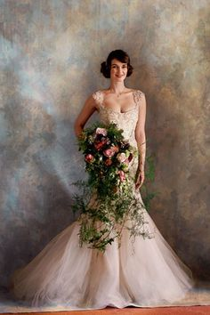 Decadent trailing bouquet (tulips, Sarah Bernhardt peonies, Quicksand roses, viburnum, asparagus ferns, anemones and trailing ivy) from By Appointment Only Design