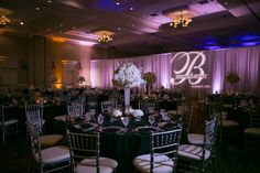 Classic, New Year's Eve Wedding Reception with Blush Pink and White Tall Centerpieces, Black Linens, Uplighting and Silver Chiavari Chairs   St. Petersburg Wedding Venue Vinoy Renaissance