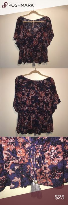 FREE PEOPLE Boho Floral Top Beautiful Boho-chic flowy shirt sleeve Blouse by Free People. Gorgeous floral pattern, ruffle gen detailing in sleeves, adorable drawstring waist with tassles, slit in scoop neck detail. This is a difficult piece to part with! It's so versatile! Can be worn with slacks and heels for the office, or with a pair of your favorite shorts and sandals for a summer night. Would also be great for those summer music festivals! Free People Tops Blouses