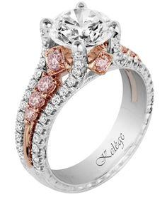Pink and Rose Accent Engagement Ring. The middle shank of this platinum engagement ring is set in rose gold and lined with 0.54 cts. t.w. pink diamond accents, also with 0.46 cts. t.w. round white diamonds.