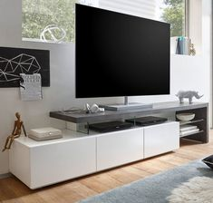 Alanis Modern TV Stand In Concrete And Matt White With 3 Drawers And Glass Shelves will look elegant in your living room. This Stunning TV Stand body is made of MDF Matt White With Top plate in MDF. Tv Stand Modern Design, Design Stand, Tv Stand Designs, Booth Design, Banner Design, Wall Unit Designs, Tv Unit Design, Tv Wall Design, House Design