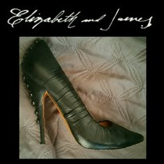 Elizabeth and James Button pump stiletto Incredibly sexy 'Jazz' pump takes your basic black pump to a new level of glam and style.  What makes them so uniquely chic  is the button up 4 inch covered high heel  molded pleating on front toe.5 inch hidden platform.  Signs of wear are specifically shown in last photo. NO TRADES PLEASE! OFFERS WELCOME THROUGH OFFER FEATURE ONLY PLEASE! Elizabeth and James Shoes Heels