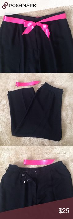 Black flowy dress pants 100% polyester dress pants with fine belt loops for accent belt. Pictured with hot pink ribbon statement belt. Elastic cinching at hips for comfortable fit. Zipper front and clasp close with inside button for extra closure. Flattering dress pants. Size 22W Pants