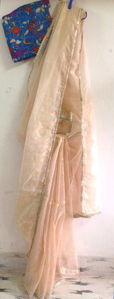 Gold tissue saree with mirror work border by GiaExquisiteIndian