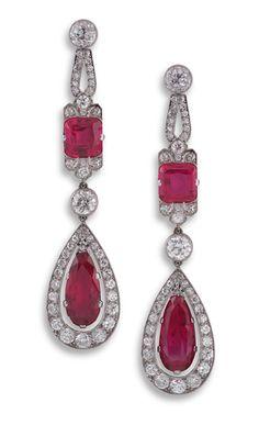 Pair of Art Deco ruby and diamond ear-pendants, each pear-shaped ruby drop in diamond frame suspended from a cushion-shaped ruby and diamond mount
