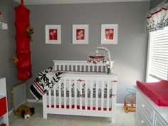 #Red hot accents in this #gray, #black & #white #nursery.