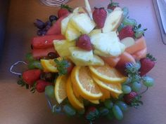 Fresh fruit tray: Watermelon, cantaloupe, strawberries, red and green grapes, fresh pineapple, orange slices, apple wedges. Catered luncheon.