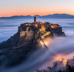 Civita di Bagnoregio, Bagnoregio, Viterbo, Italy..... www.castlesandmanorhouses.com ..... The Civita was founded by Etruscans more than 2,500 years ago. The town is noted for its position on top of a plateau of friable volcanic tuff, overlooking the Tiber river valley. The town has been placed on the World Monuments Fund's Watch List of the 100 Most Endangered Sites, because of threats it faces from erosion and unregulated tourism.