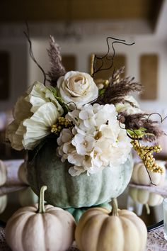 White hydrangeas and pastel pumpkins