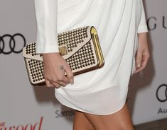 Khloe Kardashian Photos Photos - TV personality Khloe Kardashian (clutch detail) arrives at The Hollywood Reporter's 22nd Annual Women In Entertainment Breakfast at Beverly Hills Hotel on December 11, 2013 in Beverly Hills, California. - Arrivals at the Women In Entertainment Breakfast