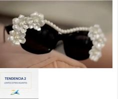 LENTES EXTRAVAGANTES < March 2014 Daniela Wong commentator channel 2 Mexico features stills of Mercura NYC Crystal Slot Sunglasses, Pearl & Rose Sunglasses,Heart on Heart Sunglasses Pearl Round Sunglasses, & Balloon Sunglasses with Pink Magnolia, Cat in the Moon Sunglasses