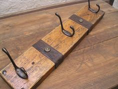 Handmade wooden rustic coat rack  /  towel holder / bathrobe hanger. $32.00, via Etsy.