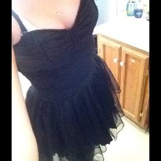 Black corset dress from Royal bones Super cute corset dress from hot topic. It is like new and only worn one time. Sweetheart neck line with lace and a tutu like bottom. Hot Topic Dresses