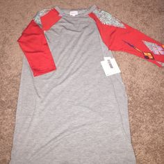 LuLaRoe Sloan Tee Super soft, super comfortable lightweight 3/4 sleeved tee. This size could easily fit an adult small or a petite medium. LuLaRoe Tops Tees - Short Sleeve