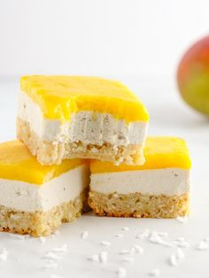 This mango coconut bar recipe is the perfect summer dessert. Vegan and gluten-free! A flaky and toasty shortbread base, creamy coconut middle, and fresh mango topping. #vegandessert #mangobar #coconut #summer #veganrecipes