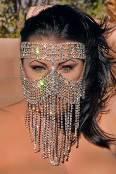 "Swarovski - Genuine Austrian Crystal Rhinestone, Oversized, Fantasy Mask.    11"" long in the center. Mask fastens securely around the head with elastic bands. Some rhinestone strands are on the sides of the head close to the face"