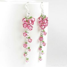Cascading Tea Rose Swarovski Crystal Earrings are handmade with cascading clusters of Swarovski crystals in soft rose with tiny green accents.