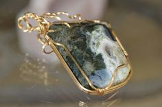"""It's like a """"moonrock"""" from the City of Oz!    This stunning pendant is more than a statement piece - the Jasper stone's energy is known for being a nourishing and warm; and is especially helpful for people who can get easily burnt out.    Matching Moss Agate earrings.  Set is gold-fill hand wrap..."""