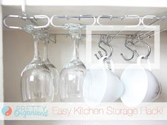 8 Clutter Problems Solved by Shower RingsPrefer a hanging glass rack? Doctor it up to hold mugs, too, with some well-placed hooks.