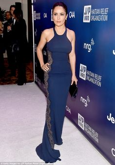 Stunning: Salma Hayek dazzled in a clinging navy gown as she attended the 4th Annual Sean ...
