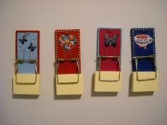 Mouse traps turned into note holders. They have a magnetic strip on the back.