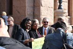 Kathryn Freeman (left), Texas Baptists' Christian Life Commission director of public policy, Texas State Rep. Senfronia Thompson (middle), and Gus Reyes (right), Texas Baptists' Christian Life Commission director, pose for a picture following a press conference about ending human trafficking on the steps of the Texas Capitol on Thursday, Feb. 12, 2015.
