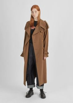 Brown double-breasted trench coat in cotton drill, with oversized epaulettes and an adjustable self-tie buckled belt. Classic fit. Dropped shoulders. Front welt