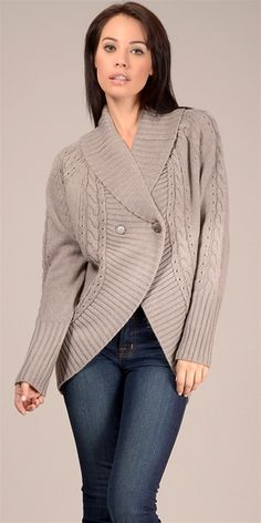 GILBER GILMORE cocoon knit sweater ribbed along the collar and sleeves piped with cable knitting along the body. - 2 button front fastening- 90% Merino Wool- 10% Cashmere- Hand wash/ Lay flat to dryAll Sale Items are Final Sale