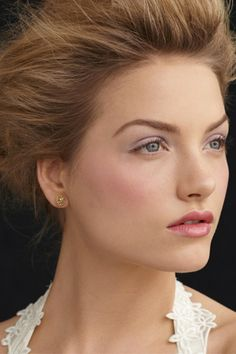 English Rose  For this modern twist on the old bridal standby, Campo dusted lilac shadow across the eyelids and used matching shades of rose on the cheeks and lips.
