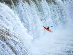 Picture of a kayaker going over waterfalls at Agua Azul River, Chiapas, Mexico
