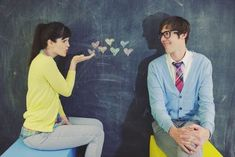 """Yet another reason we ALL need chalk walls. """"I think these are super cute engagement photos (click on the link to see more) - this would also make a really cute photo booth idea for at the wedding itself"""""""