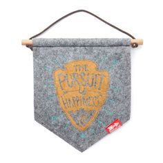 Story  Pursue happiness and you will find it in the pursuit itself  Jeremy Collins, the artist behind all of the hand drawn artwork on Meridian Line products, likes to think of his brand as a story he tells with illustrations. The Pursuit Banner Art features one of Meridian Line's classic sentiments that sums up what they do and, well, it sums up what we do pretty well too. Get out of the house and pursue something — we'll see you out there.  Features  Wall art featuring the The Pursuit…