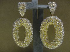 Yellow gold ovals with white diamond earrings. Available at www.yanina-co.com, 800-780-3433.