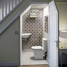 There are lots of methods to create under stair storage space. I really like the manner that this under stair storage space stipulates a desk area for those kids. Bathroom Under Stairs, Basement Bathroom, Bathroom Plumbing, Toilet Under Stairs, Bathroom Faucets, Bathroom Storage, Bathroom Mirrors, Bathroom Styling, Downstairs Cloakroom