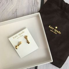 Kate Spade bow earrings Brand new gold Kate spade earrings. Comes with dust bag no box. Bracelet sold separately kate spade Jewelry Earrings