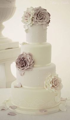 Love this! Tone the Lemon tiers to a pale sage, alternated with ivory tiers topped with ivory flowers, edged in silver ribbon with pearls.