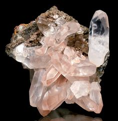 Fine cluster of Calcite crystals on matrix. From the Stank Mine, Barrow, Cumbria, England.