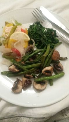 Salmon garnished with peppers & onions and spinach, green beans and chestnut mushrooms!