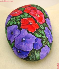 Hand painted rock  Red and purple petunias.