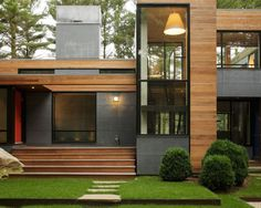 Nice mix of wood, metal, glass, concrete    Kettle Hole House by Robert Young | HomeDSGN, a daily source for inspiration and fresh ideas on interior design and home decoration.