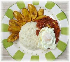 Rice, corned beef, fried egg, and plantains... yummy